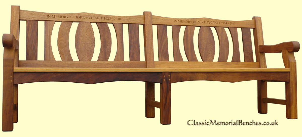 A memorial bench with a stain on the wood