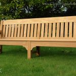 Large oak bench in a garden