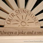 Close up of a sunshine bench with a text engraving