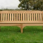Large memorial bench in a garden