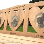 Thee heart shaped panels with photo carvings of dogs on
