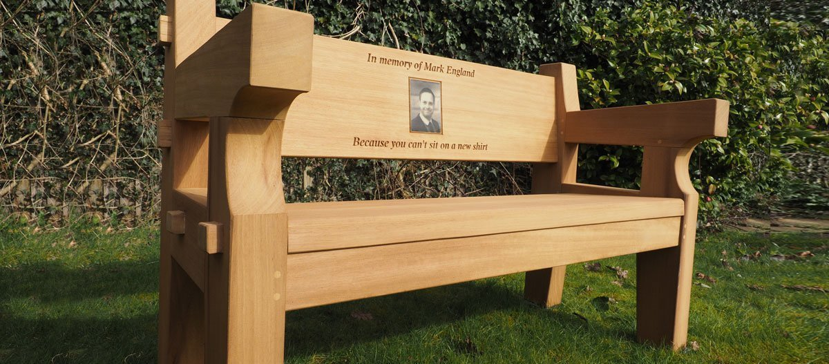 Chunky iroko memorial bench with a photo carving
