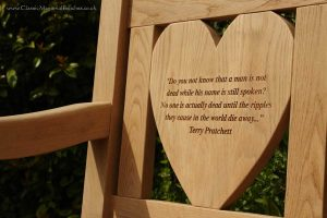 Heart shaped back left panel engraved with a Terry Pratchett quote