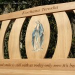 Iroko bench with a central resin inlay of The Virgin Mary