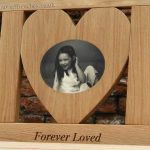Heart shaped center panel with an oval photo carving of a young girl