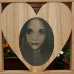 Heart shaped center panel with a photo carving of a young woman
