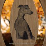 Close up photo carving of a whippet dog