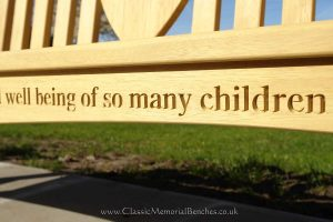 Close up of a bottom rail which says 'well being of so many children'