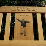 Iroko memorial bench with a photo carving of a dancing man