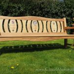 Iroko memorial bench with three back panels, all with resin inlays and word engravings