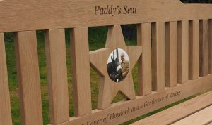 Star shaped center panel with a photo plaque of a man with a horse