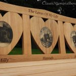 Iroko memorial bench for three dogs, with three heart shaped panels each with a photo carving of a dog on