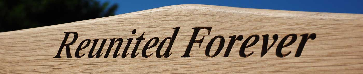Close up of an engraving which simply says 'Reunited Forever'