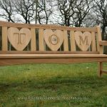 Bench with three heart shaped panels, which together spell the name 'TOM'