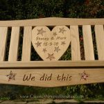 Bench with heart shaped canter panel with inlay-ed stars filled with shiny stones