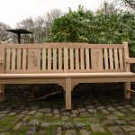Oak bench with two engraved panels