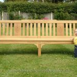 Bench in the garden with a toddler in front